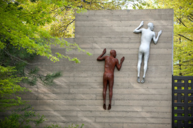 """At the main gate at Mission Hill Family Estate, two life size sculptures climb the winery's massive battered wall attempting to join the exhibition inside. Sculpture Names: """"Echo 1 & 2"""" (CNW Group/Mission Hill Family Estate)"""