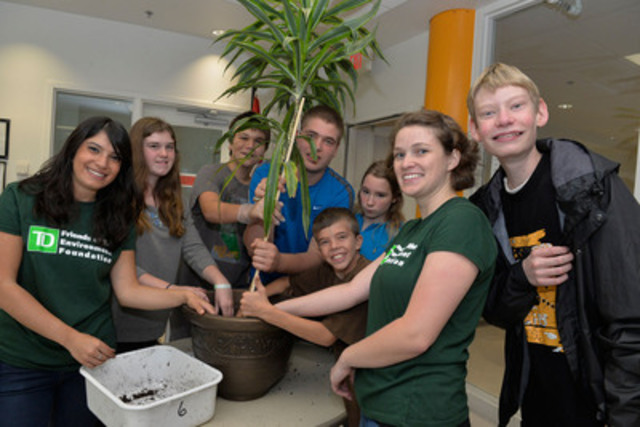 TD employee volunteers help plant legacy trees with YMCA Academy students to celebrate $1-million donation announced this morning at the Toronto Central Grosvenor Street YMCA. (CNW Group/YMCA of Greater Toronto)