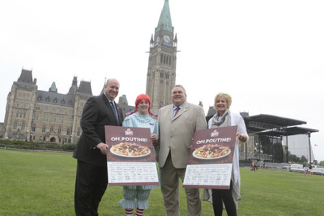 "Susan Allison, franchisee, Wendy's Restaurants of Canada and member of the Canadian Franchise Advisory committee and Wendy present the ""Poutition"" to MPs Dean Allison and Joe Preston. Citizens of Canada have signed the petition requesting Parliament to declare poutine to be the national dish of Canada. Show your support and sign the Poutition at www.poutition.ca. (CNW Group/Wendy's Restaurants of Canada)"