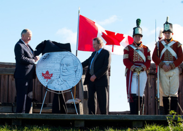 The Honourable Rob Nicholson, P.C., Q.C., Member of Parliament for Niagara Falls, Minister of Justice and Attorney General of Canada and Royal Canadian Mint President and CEO Ian E. Bennett unveiled the new 25-cent circulation coin honoring War of 1812 hero Major-General Sir Isaac Brock at the Fort George National Historic Site. (CNW Group/Royal Canadian Mint)