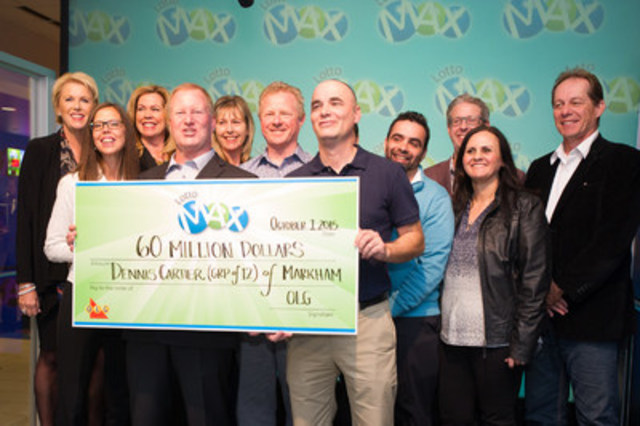 Twelve Toronto area co-workers are presented a record high $60 million LOTTO MAX cheque at the OLG Prize Centre in Toronto, ON. (CNW Group/OLG Winners)