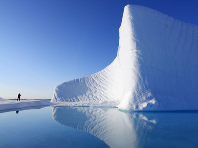 Auyuittuq and Sirmilik National Parks - A pristine iceberg stands out starkly against Nunavut's blue skies. (Photo Credit: John E. Marriott, Corbis) (CNW Group/National Geographic Society)