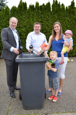 (right to left) Port Moody resident Alison Bogan and family join Port Moody Mayor Mike Clay and MMBC Managing Director Allen Langdon in adding a few of the new items accepted for recycling today, thanks to the industry-funded Multi-Material BC program. (CNW Group/Multi-Material British Columbia (MMBC))