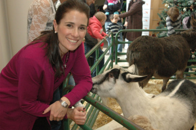 World Vision Gifts Spokesperson Molly Finlay with a goat, a popular charity present. (CNW Group/World Vision Canada)