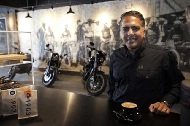 Anoop Prakash, Managing Director, Harley-Davidson Canada, enjoys a coffee at 1903 – A Harley-Davidson Café located at 96 Ossington Avenue in downtown Toronto which opens today. The café is a bold step towards making the company's motorcycles and lifestyle more accessible to both experienced riders and those new to the sport. (CNW Group/Harley-Davidson Canada)