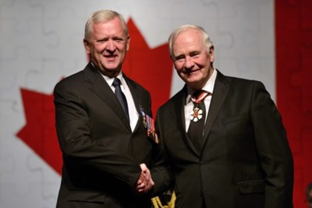 His Excellency the Right Honourable David Johnston, Governor General of Canada presents the Meritorious Service Medal (Civil Division) to Major James Gerald Lynch, M.S.M., C.D. (Retired). Photo credit: MCpl Vincent Carbonneau, Rideau Hallo, © OSGG, 2016 (CNW Group/Commissionaires)