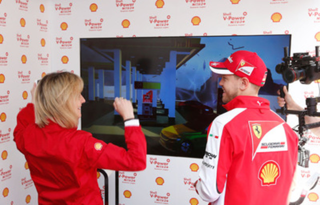 Sebastian Vettel, Four time Formula One World Champion and current Scuderia Ferrari Driver challenged Sydney Kimball, General Manager of Shell Canada Retail today on the Shell V-Power NiTRO+ Unleashed game, demonstrating the new Shell V-Power® NiTRO+ Premium Gasoline which offers total engine protection from gunk, wear and corrosion. (CNW Group/Shell Canada)