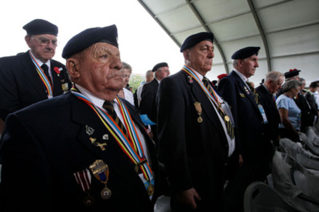 (L-R) Canadian Veterans Joseph Wilson, Oswald Landry and Leo Rose remember the fallen during a commemorative ceremony at the United Nations Memorial Cemetery in Busan, South Korea. (CNW Group/Veterans Affairs Canada)