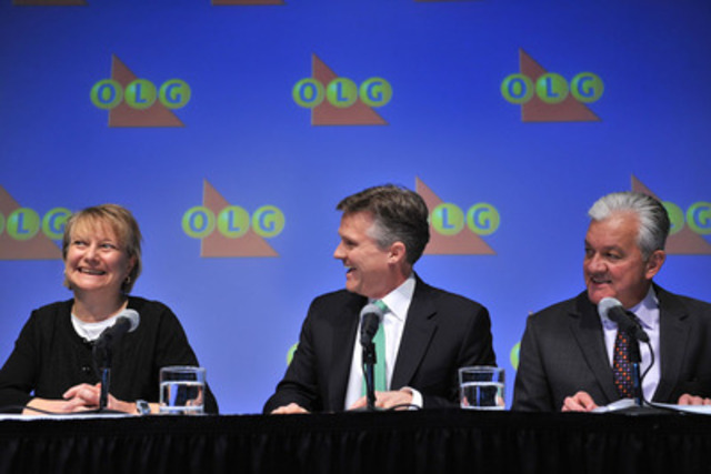 OLG's President and CEO Rod Phillips (centre) and Mike Hamel, OLG's Director of Corporate Investigations, announce Kathryn Jones of Hamilton as the identified winner of the the outstanding $50 million LOTTO MAX jackpot from the November 30, 2012 draw. (CNW Group/OLG Winners)