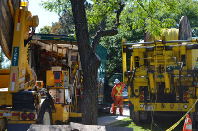 Toronto Hydro trucks and equipment occupy the sidewalk to replace a number of cables that have failed and caused numerous outages in the past year. Due to systemic failures, the cable needs to be replaced altogether. Approximately 40 per cent of outages on Toronto Hydro's grid are caused by equipment past its normal life span. (CNW Group/Toronto Hydro Corporation)