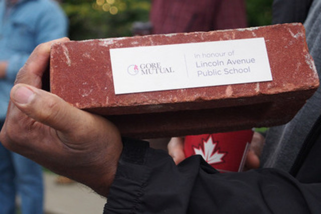 Local resident receives commemorative brick from Gore Mutual Insurance Company (CNW Group/Gore Mutual Insurance Company)