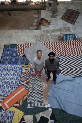Holt Renfrew's Director of Brand Strategy, Alexandra Weston with Waris Ahluwalia at a carpet studio in Jaipur, India (CNW Group/Holt Renfrew)