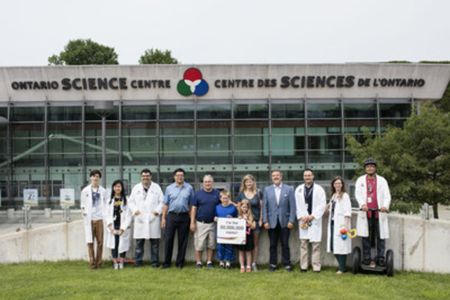 The Ontario Science Centre welcomed its 50 millionth visitor since opening its doors almost 46 years ago. The lucky visitor family, the Roys (centre) from Middletown, CT, were greeted by CEO Dr. Maurice Bitran (fourth from right) and Board Chair Brian Chu (fourth from left), along with Science Centre hosts. (CNW Group/Ontario Science Centre)