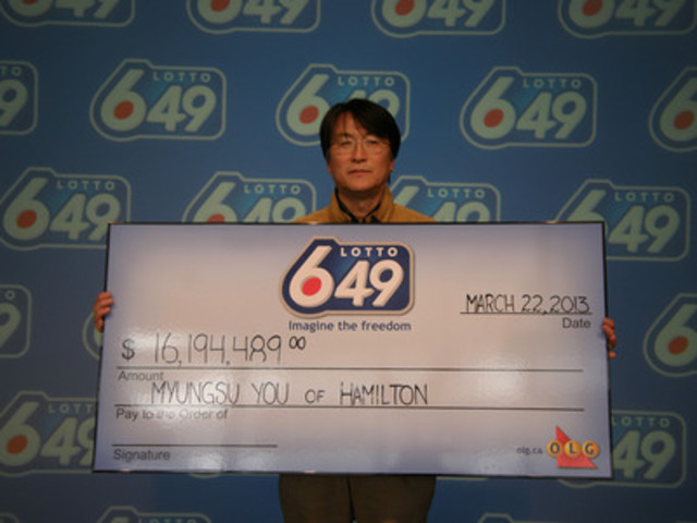 Hamilton resident Myungsu You claims his $16.1 million LOTTO 6/49 jackpot prize from the June 30, 2012 draw, after completing the Ontario Lottery and Gaming Insider Win claims process on March 22, 2013. (CNW Group/OLG)