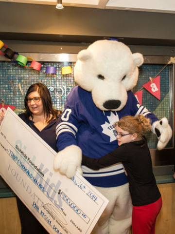 Toronto Maple Leafs mascot Carlton the Bear visited The Hospital for Sick Children to present Phil Kessel's winnings from the NHL Alumni Charity Poker Tournament presented by PokerStars.net. Kessel won $15,000 in the charity poker tournament and matched the amount with a $15,000 personal donation, for a total donation of $30,000 to SickKids Foundation. (CNW Group/PokerStars.net)