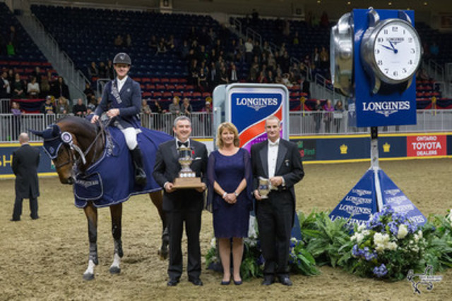 McLain Ward is presented as the winner of the $130,270 Longines FEI World Cup™ Jumping Toronto. From left to right: Charlie Johnstone, CEO of The Royal Agricultural Winter Fair, Iain Gilmour, Chairman of the Royal Horse Show, and Connie Sawyer, Manager of the Longines FEI World Cup™ Jumping North American League. (Photo by Ben Radvanyi Photography) (CNW Group/Royal Agricultural Winter Fair)