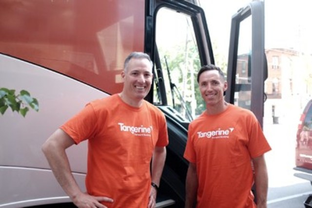 Tangerine President and CEO, Peter Aceto, and Steve Nash boarding Tangerine's #BrightWayForward bus today to lend a hand at three local charity partners. (CNW Group/Tangerine)