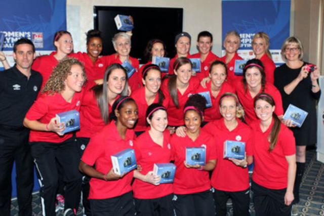 Members of the Canadian Women's National Soccer team show off their new Canon PowerShot cameras, presented to them by Colleen Ryan Senior Director of Corporate Communications, Canon Canada, at right. (CNW Group/Canon Canada Inc.)