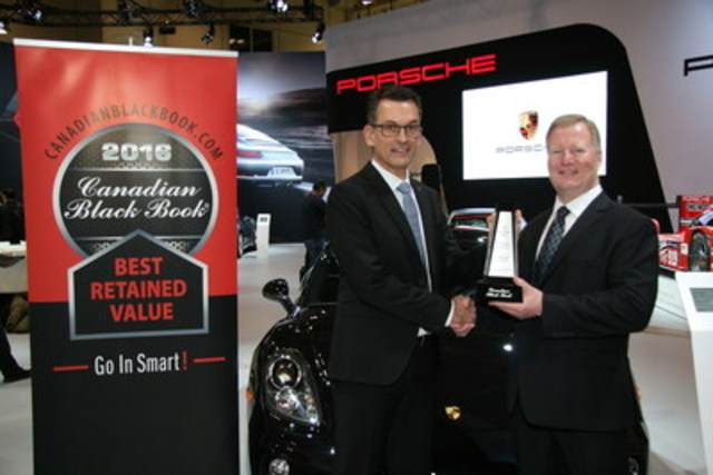 Brad Rome from Canadian Black Book presents to Alexander Pollich, President and CEO, Porsche Cars Canada, Ltd. with the 2016 Best Retained Value award for the Cayman at the Canadian International Auto Show in Toronto on Thursday, February 11, 2016. (CNW Group/Porsche Cars Canada)
