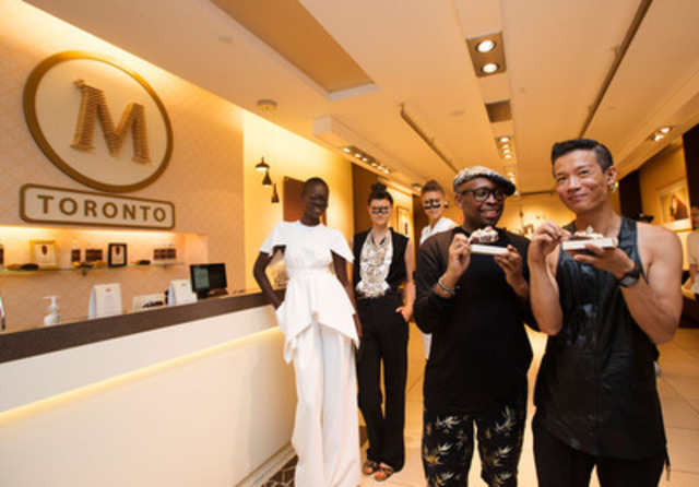 Fashion designers Kirk Pickersgill, left, and Stephen Wong, right, of Greta Constantine pose for a photo with models and their custom Magnum ice cream bars at Toronto's Magnum Pleasure Store on July 15th, 2013. (Michelle Siu for CNW) (CNW Group/Magnum)
