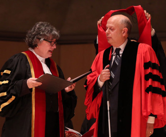 Law Society Treasurer Janet E. Minor confers the title of Doctor of Laws, honoris causa, LLD, on lawyer David Lepofsky C.M., O.Ont., while he receives the LLD hood at the afternoon Call to the Bar ceremony on June 21 in Toronto. Lepofsky received the honorary degree in recognition of his tireless advocacy for accessibility rights in Canada. His leadership has effected legislative amendments to the Canadian Charter of Rights and Freedoms, the Ontarians with Disabilities Act and the Ontario Human Rights Code to protect and ensure accessibility and equality rights for all persons with disabilities. (CNW Group/The Law Society of Upper Canada)