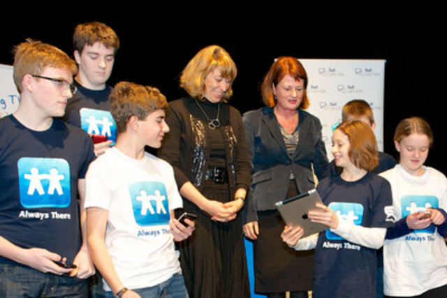 "Sharon Wood, Kids Help Phone's President and CEO, and The Honourable Laurel Broten, Ontario Minister of Education and Minister of Children and Youth Services, unveil Kids Help Phone ""Always There"", Canada's first mobile app connecting youth to live professional help and support. Being there through technology is an organizational priority for Kids Help Phone. (CNW Group/Kids Help Phone)"