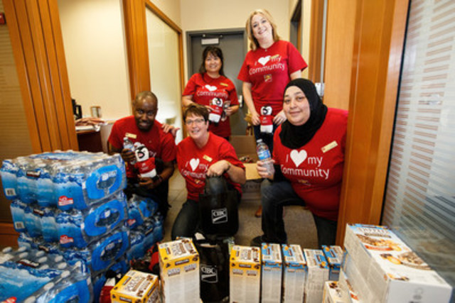 (From left) John Mbirimujo, general manager Cecily Clarke, Maria Umbalin, Gaye King and Hillwie Fayad fill client care packages at the CIBC Fort McMurray Banking Centre. THE CANADIAN PRESS IMAGES/Codie McLachlan (CNW Group/Canadian Imperial Bank of Commerce)