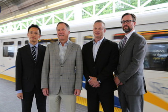 Rogers and TransLink celebrate turning on wireless service for Rogers and Fido customers in the SkyTrain Dunsmuir Tunnel. From left to right: Derrick Cheung, Vice-President Strategic Sourcing and Real Estate, TransLink; Gord Nelson, Vice-President, Sales, British Columbia, Rogers Communications; Leon Leroux, Director, Network Implementation, Western Region, Rogers Communications; and Guy Akester, Director, Real Estate Program and Partners, TransLink. (CNW Group/Rogers Communications Canada Inc. - English)