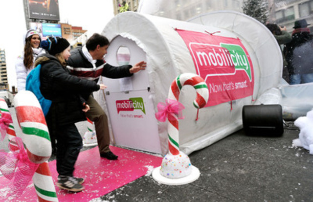 Homesick for the holidays? Mobilicity's Chief Customer Officer Anthony Booth welcomes Torontonians inside a 24-foot snow globe in Yonge-Dundas Square where they can make a free long-distance phone call to loved ones anywhere in the world. This free event runs until 8 pm on Friday and 9:30 am to 7:30 pm on Saturday, December 22nd. (CNW Group/Mobilicity)