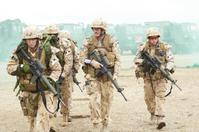 A still from HYENA ROAD featuring Paul Gross and members of the Canadian Armed Forces. Photo credit: Christos ...