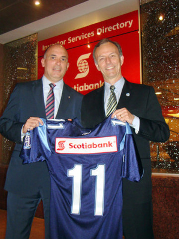 Scotiabank's Senior Vice President, Marketing, Duncan Hannay and Toronto Argonauts President and CEO, Bob Nicholson celebrate a new partnership announcing Scotiabank as the Official Sponsor of the Toronto Argonauts. (CNW Group/Scotiabank)
