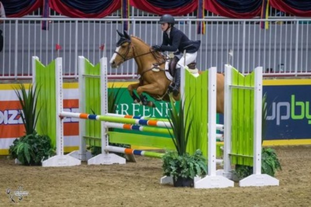 Laura Robertson of Toronto, ON, and Bloomsbury claimed victory in the $5,000 Royal Pony Jumper Final, presented by Marbill Hill Farm, at the Royal Agricultural Winter Fair. Photo by Ben Radvanyi Photography (CNW Group/Royal Agricultural Winter Fair)