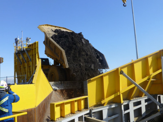 The first load of oil-sands ore at Kearl is dumped into the crusher. (CNW Group/Imperial Oil Limited)