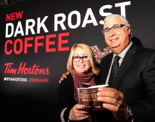 Marc Caira, President & CEO, Tim Hortons Inc., and Canada's own Jann Arden enjoy a cup of Tim Hortons Dark Roast coffee at the launch event in Toronto, ON, on Thursday. The new blend makes its North American debut at Tim Hortons restaurants across North America on Friday, August 15. (CNW Group/Tim Hortons)