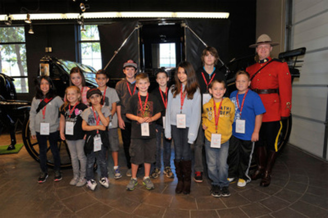 Children's Miracle Network Champions with Cst. Jeremy Tipper on an exclusive tour of the RCMP musical ride stables in Ottawa. (CNW Group/Children's Miracle Network)