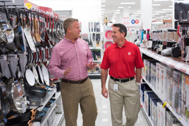 In his first week on the job, Brian Cornell, chairman and CEO of Target Corp., visits the Target store at Cloverdale Mall in Toronto, with Mark Schindele, president of Target Canada. (CNW Group/Target Canada)