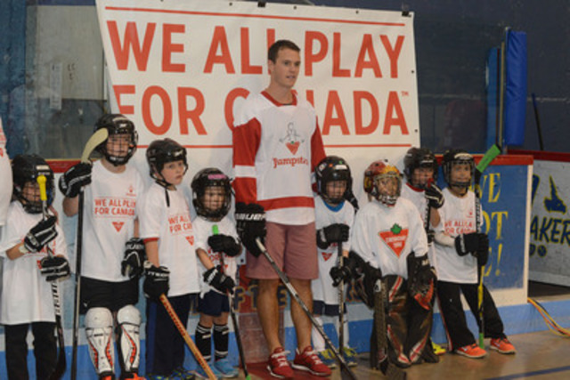 On July 31, Jumpstart Ambassador Jonathan Toews celebrates the Red Ball campaign with kids from Labrador City. Toews was in town to celebrate the success of the local Canadian Tire store winning the Jumpstart Red Ball campaign. (CNW Group/Canadian Tire Jumpstart)