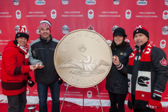 Jean-Luc Brassard, Assistant Chef de Mission, Blake Richards, MP for Wild Rose, Christine Aquino, Director of Communications and Public Affairs at the Royal Canadian Mint and Steve Podborski, Sochi 2014 Chef de Mission unveil the 2014 Lucky Loonie circulation coin at the Canadian Olympic Team's Sochi Block Party event in Banff, Alberta. (CNW Group/Royal Canadian Mint)