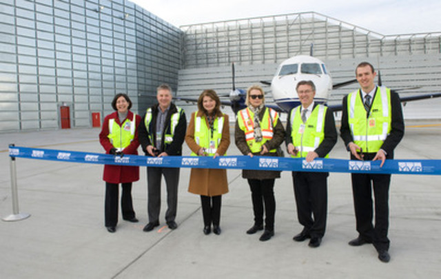 Vancouver Airport Authority opens Canada's first Ground Run-up Enclosure to reduce aircraft engine testing noise in the community. (l to r: Anne Murray, YVR; Quentin Smith, Pacific Coastal Airlines; Mary Jordan, YVR; Margot Spronk, YVR Aeronautical Noise Management Committee; Larry Berg, YVR; and Alec Garcia, Blast Deflectors Inc.) (CNW Group/Vancouver Airport Authority)