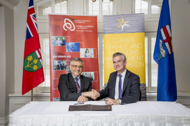 Tom Corr, President and CEO of Ontario Centres of Excellence and Steve MacDonald, CEO of Alberta's Climate Change and Emissions Management Corporation sign agreement to collaborate on reducing greenhouse gas emissions. (CNW Group/Ontario Centres of Excellence Inc.)
