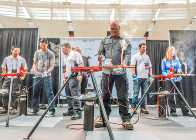 Mike Holmes, Canada' s Most Trusted Contractor and official spokesperson for Skills Canada and Canada's ToolGirl Mag Ruffman participated in a friendly soldering competition at the 19th Annual Skills Canada National Competition in Vancouver (CNW Group/SKILLS/COMPETENCES CANADA)