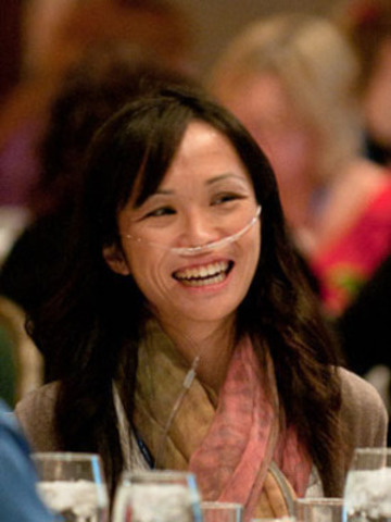Despite many limitations in daily life, such as constant shortness of breath and having to carry supplemental oxygen, many patients, such as Toronto Support Group co-leader, Loretta Chu, continue to have a positive outlook and fight back against their disease. (CNW Group/PULMONARY HYPERTENSION ASSOCIATION OF CANADA)