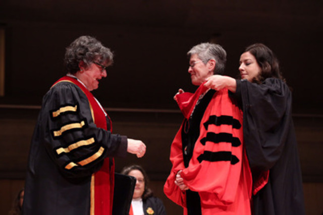 Sheila Block (centre) is bestowed the Doctor of Laws honoris causa hood by Law Society Bencher Jacqueline Horvat this morning at Roy Thomson Hall. The degree was conferred upon Block by Treasurer Janet Minor (left) at the June 24th Call to the Bar ceremony. (CNW Group/The Law Society of Upper Canada)
