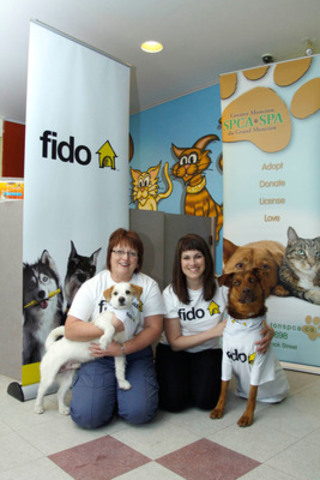 This Friday, Fido announced a $100,000 contribution to five SPCAs in the Maritime region including shelters in Moncton, Saint John, Fredericton, Halifax and Charlottetown to support needs such as veterinary care, animal protection and education. Karen Hudson, Executive Director of the Moncton SPCA (left) and Heather Robinson, Communications Manager for Fido (right), hold seven-year-old terrier mix named Squirt and two-year-old shepherd mix named Tundra. (CNW Group/Rogers Wireless and Cable)