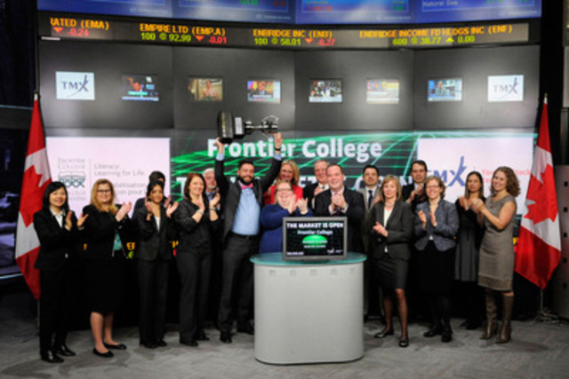 Sherry Campbell, President & CEO, Frontier College and CIBC, the winners of Frontier College's 2015 SCRABBLE® Corporate Challenge joined Eric Sinclair President, TMX Datalinx and Group Head of Information Services, TMX Group to open the market. Since 2005, the annual Scrabble Corporate Challenge, presented by TMX, has raised over $2.5 million for Frontier College literacy programs. On March 4, 2015 CIBC played against over 350 people from law firms, investment firms, financial institutions and blue chip corporations to win the TMX Cup. (CNW Group/TMX Group Limited)