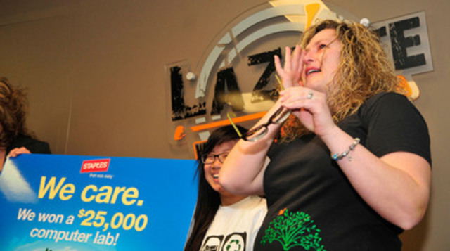Teacher Shelley Kofluk tears up when M.E. LaZerte High School in Edmonton, AB is announced a $25,000 computer lab winner in Staples Canada's Recycle for Education contest. (CNW Group/Staples Canada Inc.)