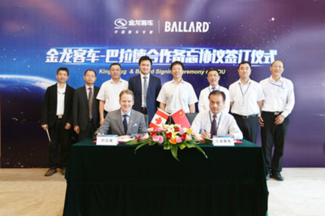 Mr. Randy MacEwen, CEO & President of Ballard Power Systems (seated left) and Mr. Lian Xiaoqiang, Chairman of the Board of King Long United Automotive Industry Co., Ltd. (seated right) during today's MOU signing ceremony (CNW Group/Ballard Power Systems Inc.)