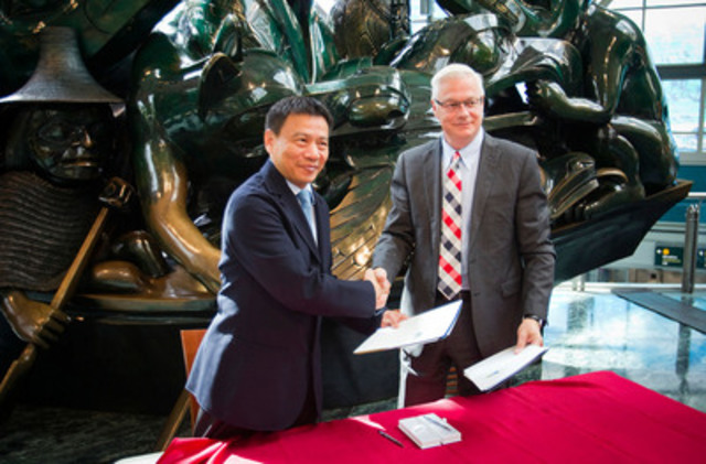 RICHMOND, B.C .: JUNE 23, 2015 -- Craig Richmond, President and CEO of Vancouver Airport Authority (YVR) shakes hands after signing a Memorandum of Understanding on Cooperation with Mr. Jing Yiming, President of Shanghai Airport Authority (SAA) at YVR airport in Richmond, British Columbia on June 23, 2015. (BEN NELMS for YVR) (CNW Group/Vancouver Airport Authority)