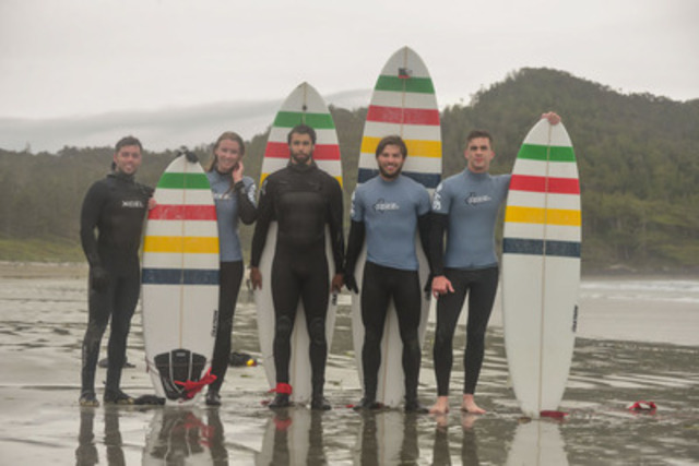 From L to R: Hudson's Bay's Project Adventure explorers Michael Simonetti, Brent Marson, Ryan Banting and Chris Arthur, get a surf lesson from Canadian Olympian, Ashleigh McIvor in Tofino, British Columbia. (CNW Group/Hudson's Bay Company)