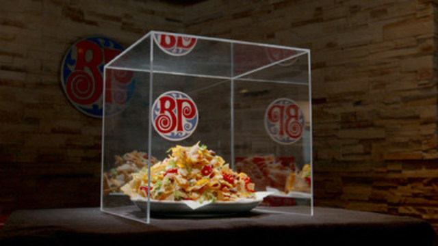 Today, Boston Pizza launched the Hey! That's Nacho Food Shield, a protective, impenetrable shield designed for guests who don't want to share their food with tablemates. (CNW Group/Boston Pizza International Inc.)